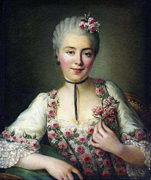 A small bouquet of flowers rest on top of the hair in, a Portrait of a Lady said to be Mlle. Dore,François-Hubert Drouais, 1765