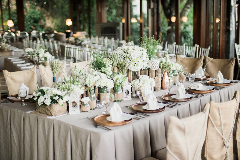 happilyevergara wedding table setting.jpg