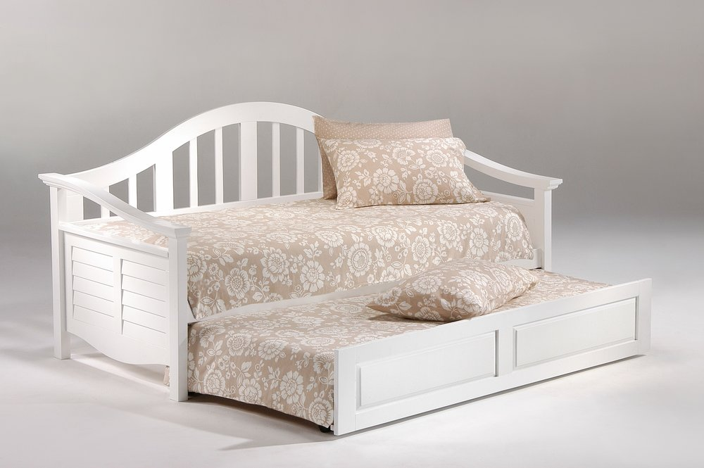 6. The Seagull Daybed - When your guests need separate beds. - When not all your guests are couples a daybed is the perfect solution. For a Florida look it would be hard to beat the Seagull Daybed.The trundle sits on the floor and can roll all the way out to become 2 separate Twin size beds perfect for 2 kids. The option is available to purchase with a pop-up trundle instead of the roll out trundle and this will give you a king size bed but for some these can be hard to operate and you loose the beauty of the wood trundle and would have to do a fabric skirt instead.If storage is a priority, the daybed can be purchased with 2 easy roll under extra deep storage drawers instead of the trundle.