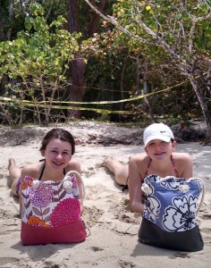 "Twins, Katherine and Bridget White, 14, beaching it in St. John with their ""Pinky Tuscadero"" & ""Make It Snappy, Poppy"" Bosun style PORT•SACKS. (Submitted by Greg White; photo taken in St. John.)"