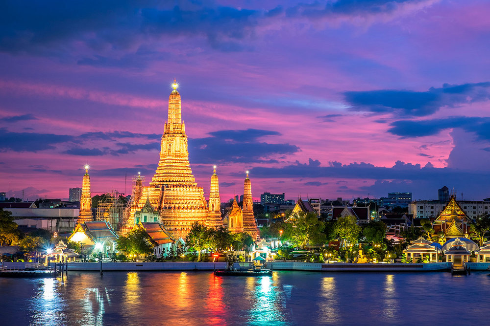 Wat Arun and the Chao Phraya River during sunset in Bangkok