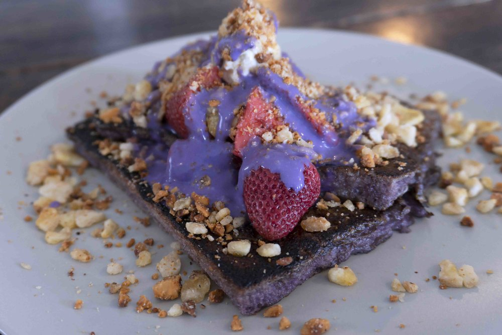 Prench Toast  purple yam infused french toast, whipped honey butter, pickled strawberries, banana hazelnut crumble, toasted coconut sauce