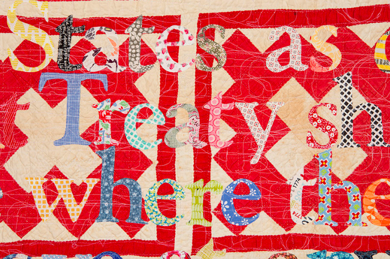 Gina Adams,  Treaty of Guadalupe Hildago 1848 Broken Treaty Quilt  (detail), 2018, hand cut calico letters and cotton thread on antique quilt, 85 x 80 inches