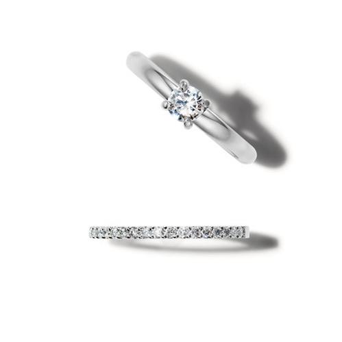 Classic platinum rings with brilliant diamonds.