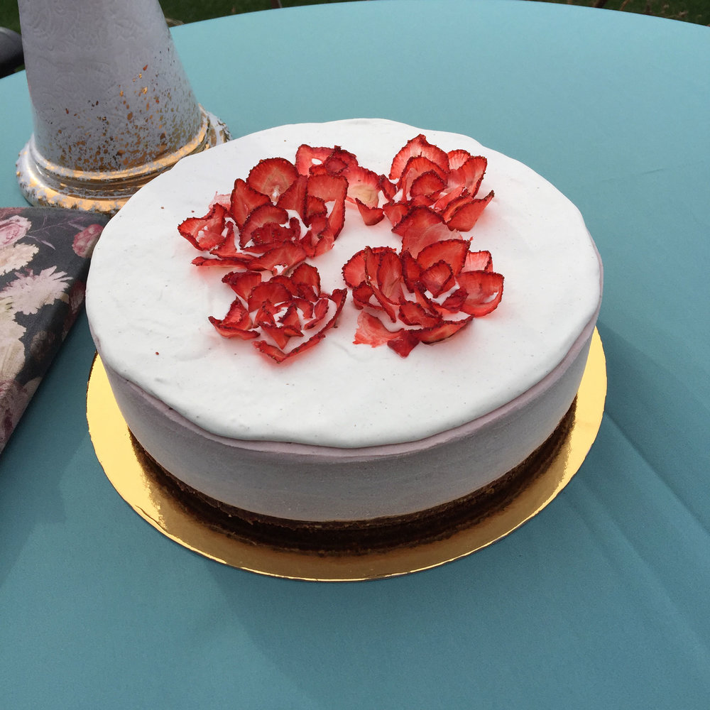 Full size strawberry vegan cheesecake by Little Wanderer Vegan Desserts in Edmonton