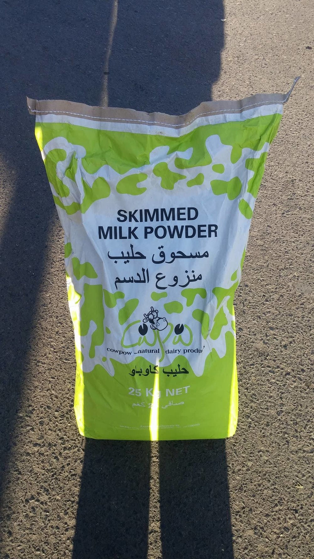 Dhamar milk Muaad delivering this morning.jpg