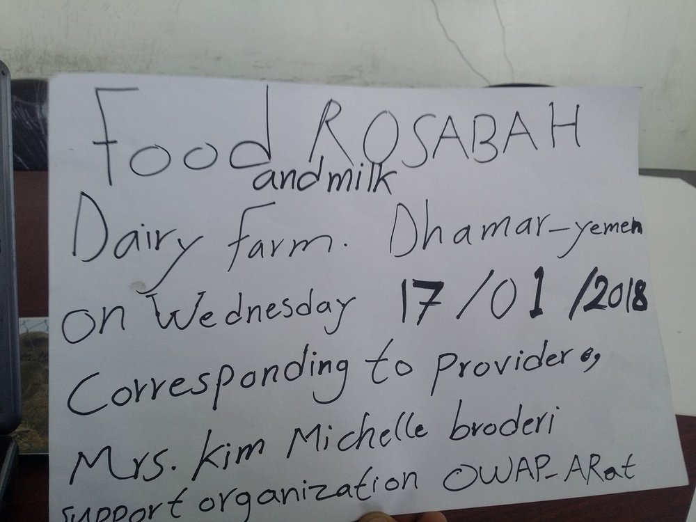 Dhamar rosabah farm cow rescue 17 Jan 2018 with Fateh sign bran hay milk.jpg