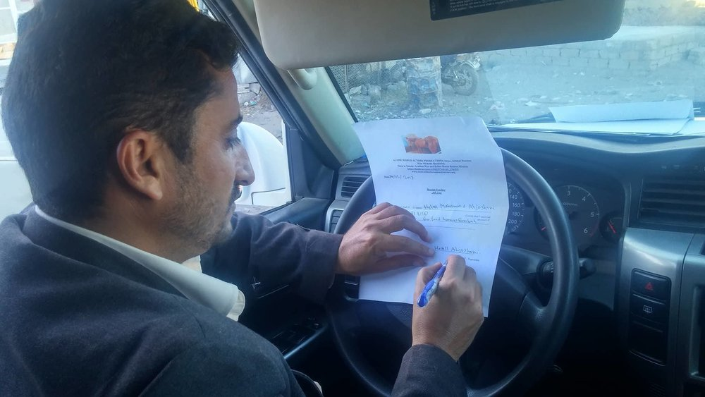 Dhamar helall signing receipt of supplies and food money 30 DEC 2017  OWAPAR.jpg