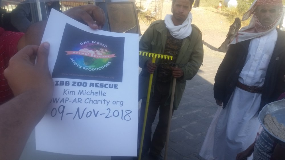 ibb zoo 9 NOV 2018 hisham pic with OWAP-AR sign cleaning toold provded by our Charity yemen rescue.jpg
