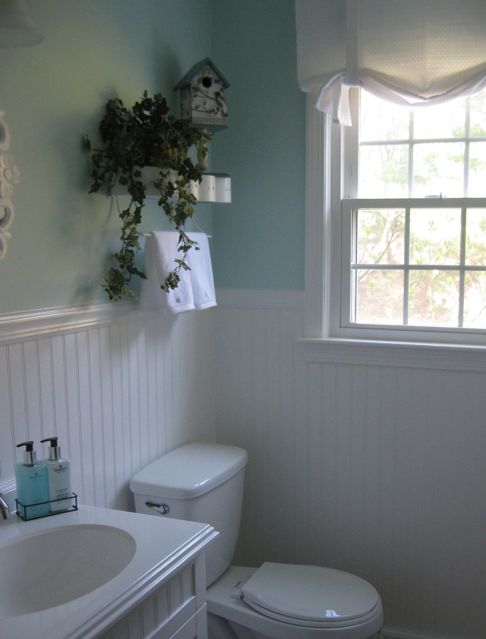 - Robins egg blue walls and crisp white trim give this sunny powder room an airy feel