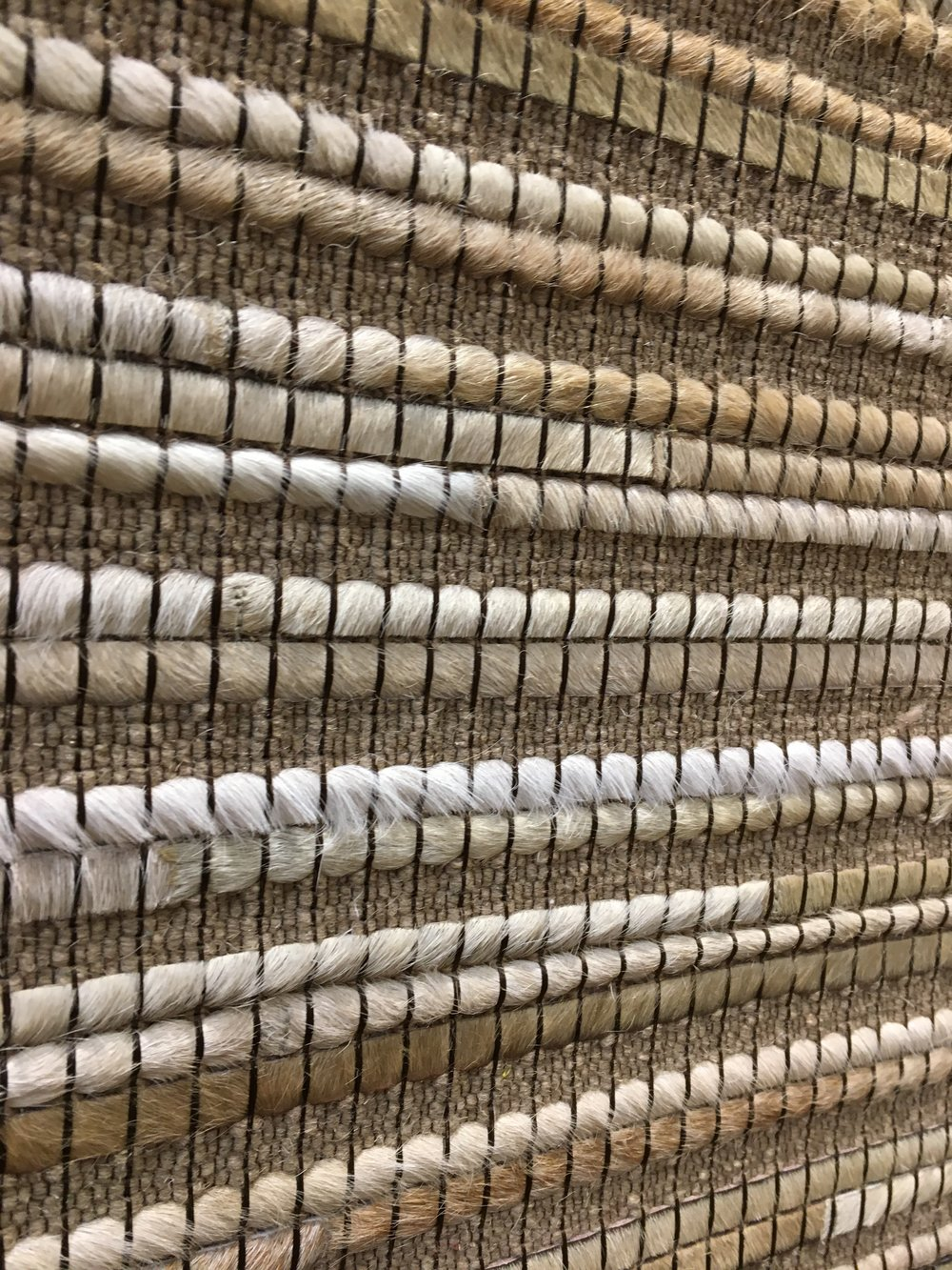 Woven fiber area rug