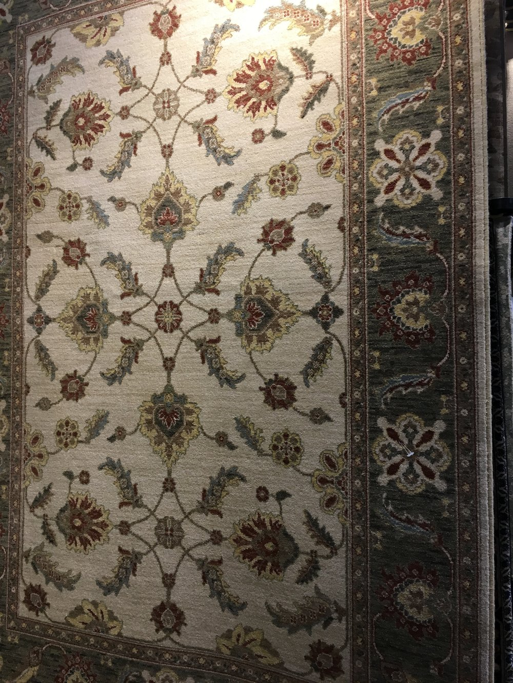 green bordered area rug