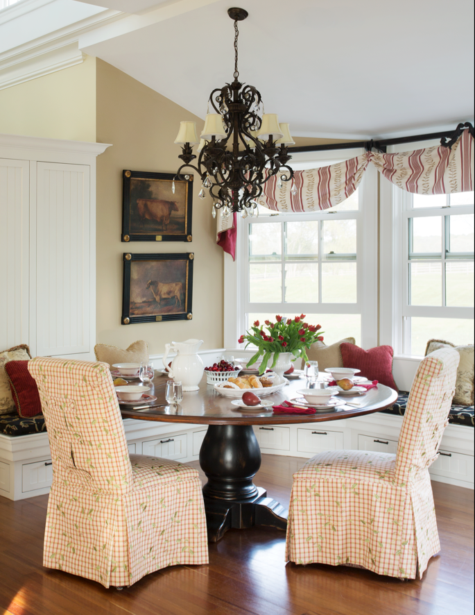 It's hard to see here, but we added tabs with covered button details across the inverted pleats on the back of these parson chair slipcovers for this gorgeous kitchen eating area.