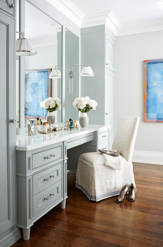 An upholstered parsons chair provides the vanity seating in this elegant dressing room by   Anne Hepfer
