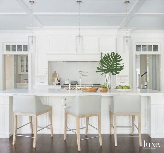 Upholstered stools from Jessica Charles are the perfect addition to the island in this kitchen by Michelle Morgan Harrison. Photo by Jane Beiles via   Luxe