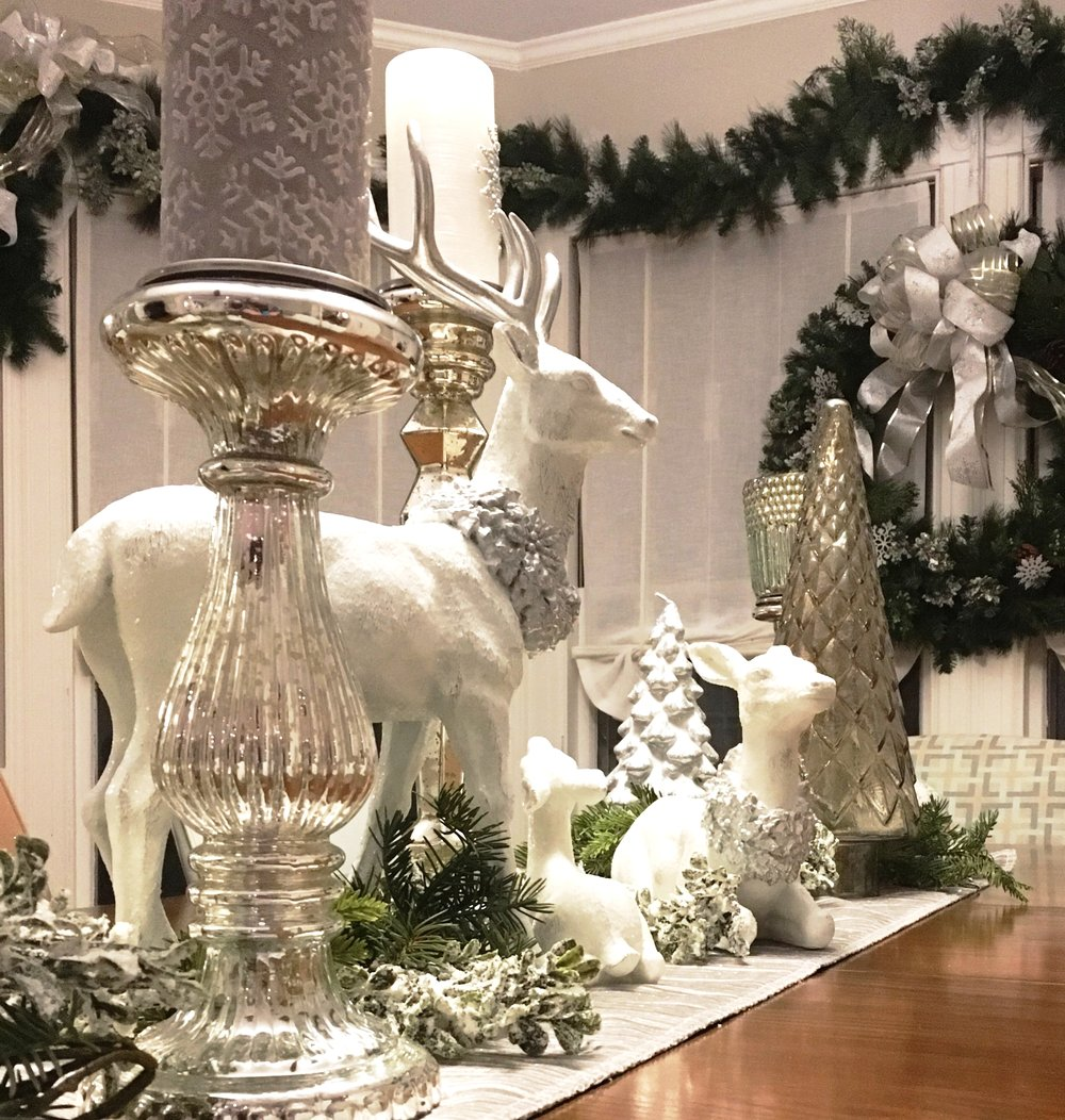 Winter tablescape with white and silver and evergreens