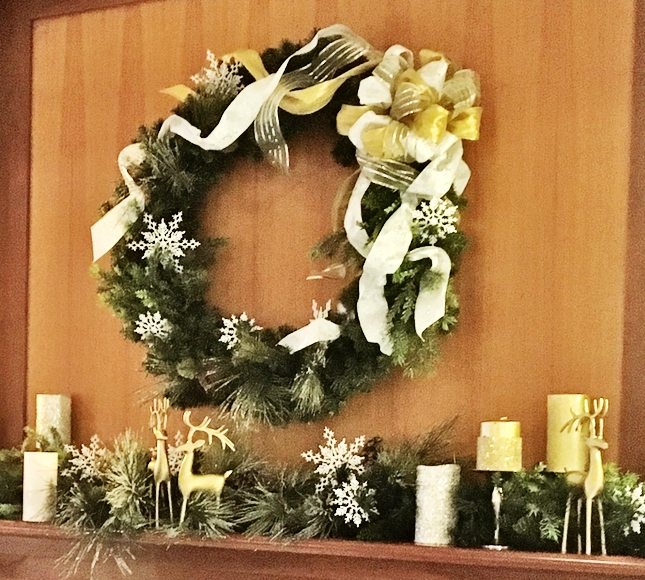 Here we used the clients wreath, accessories, and greens. Adding only a base of evergreen garland and yards of ribbon we were able to restyle everything for a beautiful fresh look.