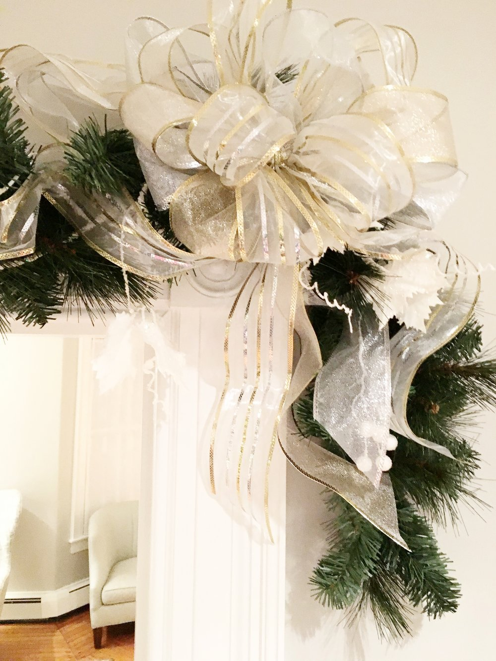 "These ethereal bows for the corners of archway garlands are comprised of three 2 1/2"" wide sheer and semi-sheer ribbons. Each bow has 6 triple loops for a total of 18 loops."