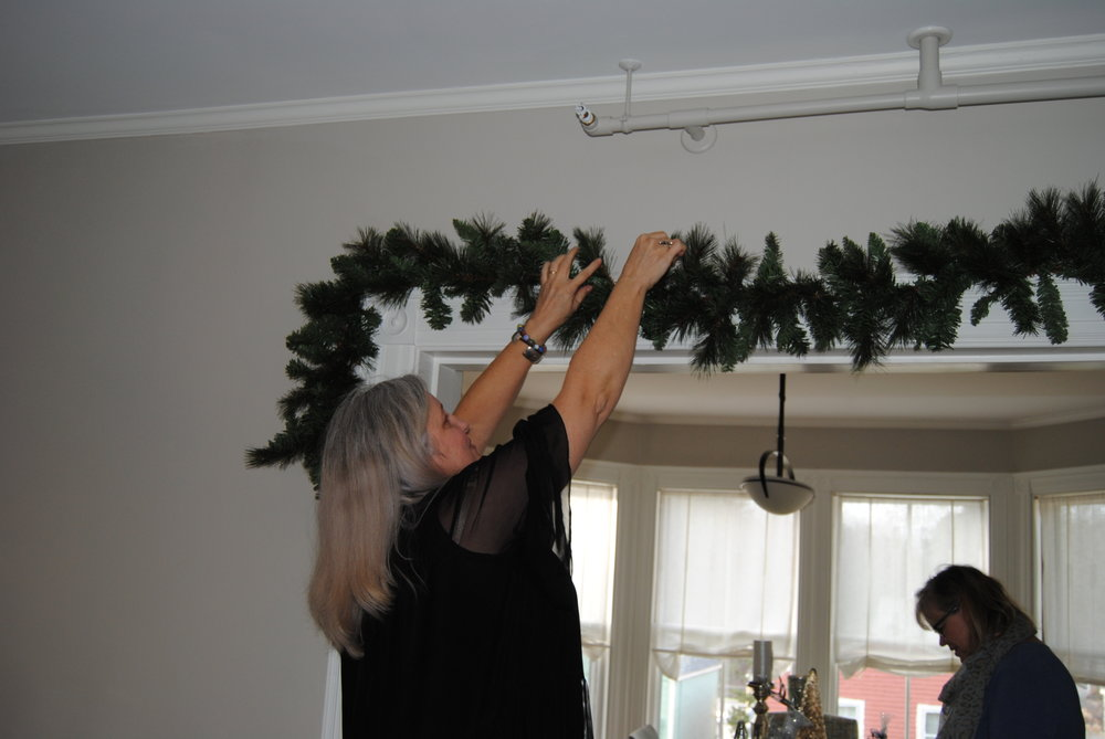 The first garland going up while table styling is happening in the background