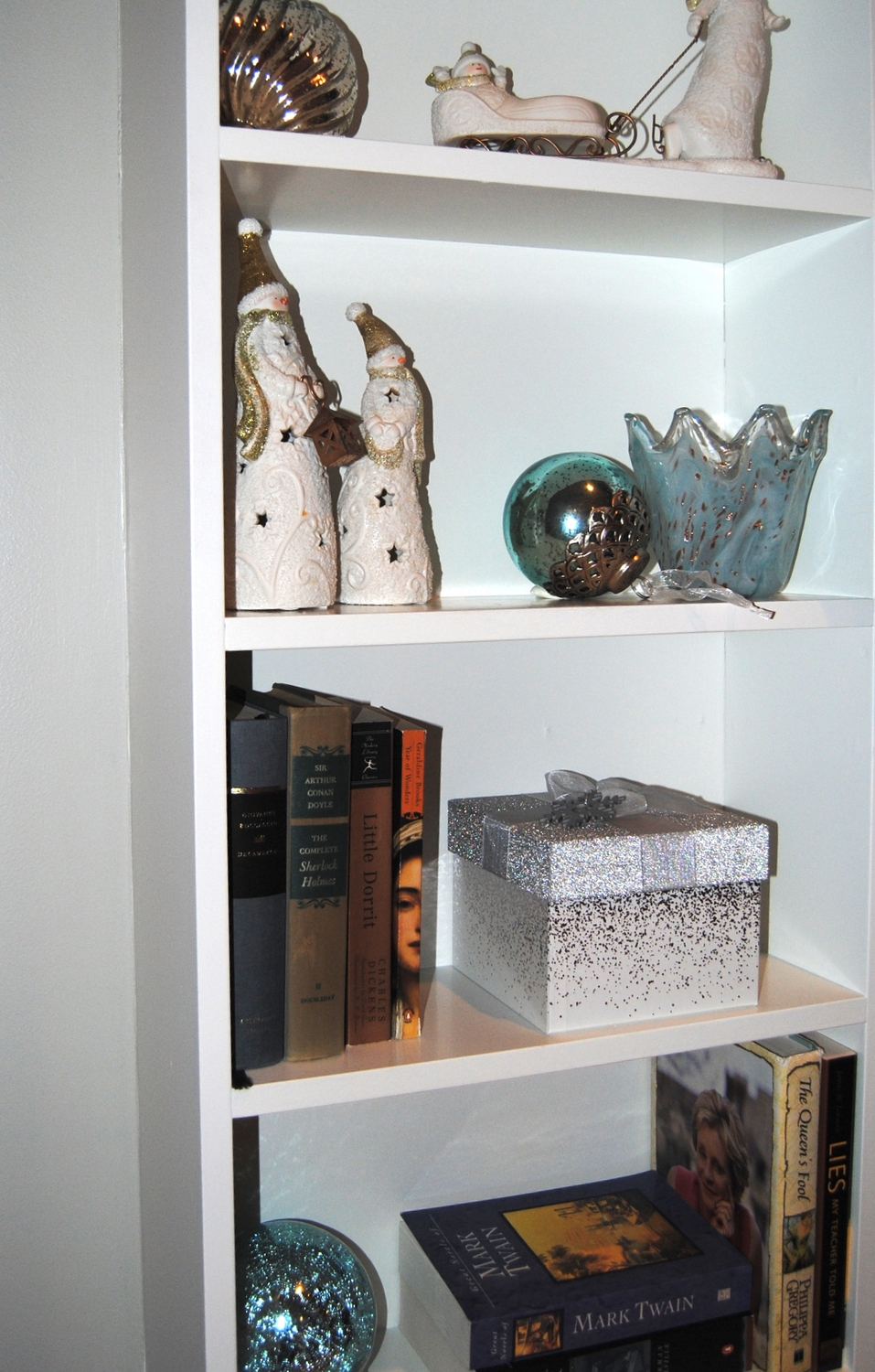 The fixed shelves around the fireplace were styled with the innkeepers books, accessories, and ornaments