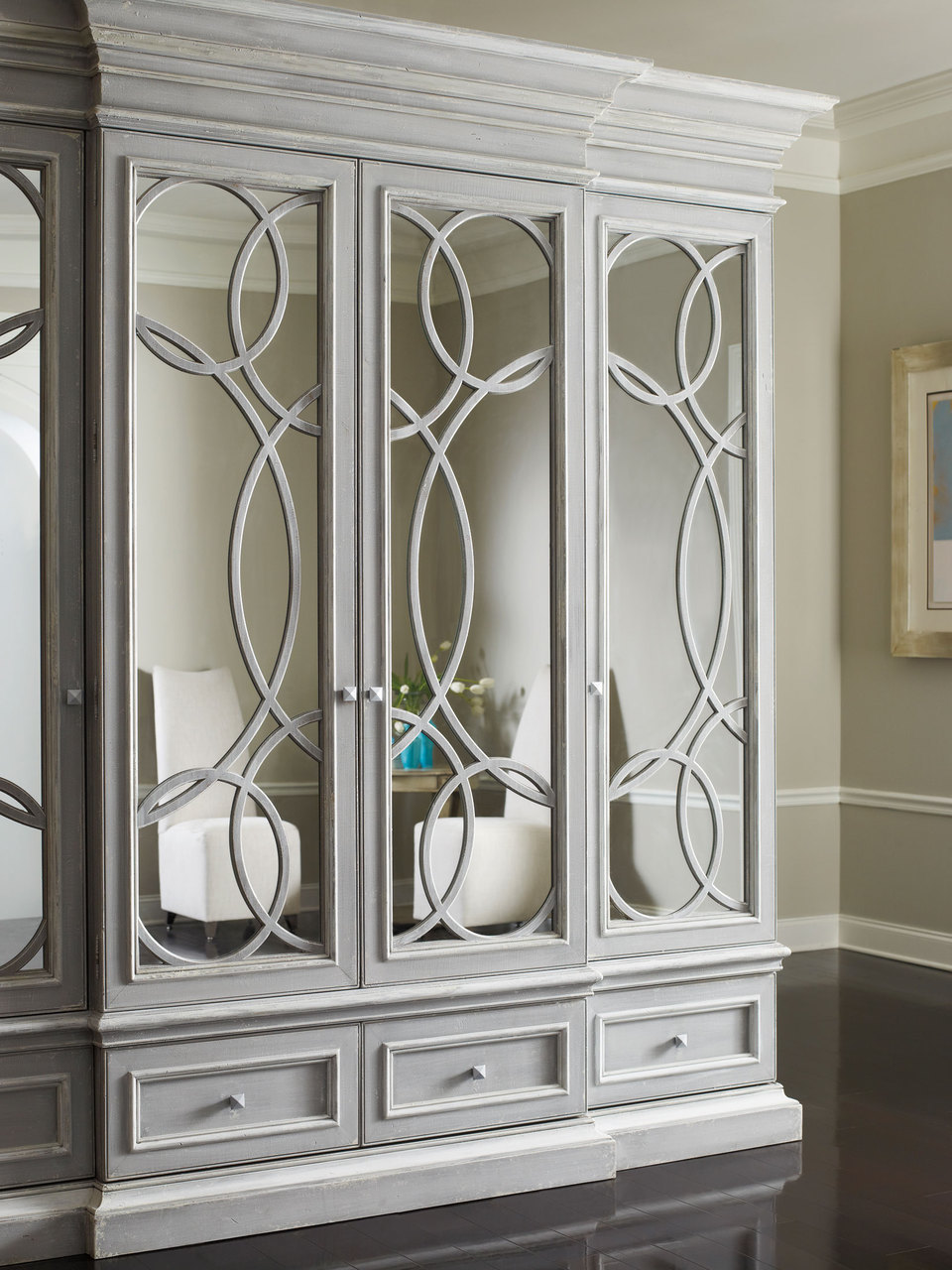 This East Hampton Media Cabinet with mirrored doors by   Habersham     would be an elegant way to hide the TV in a more formal living space.