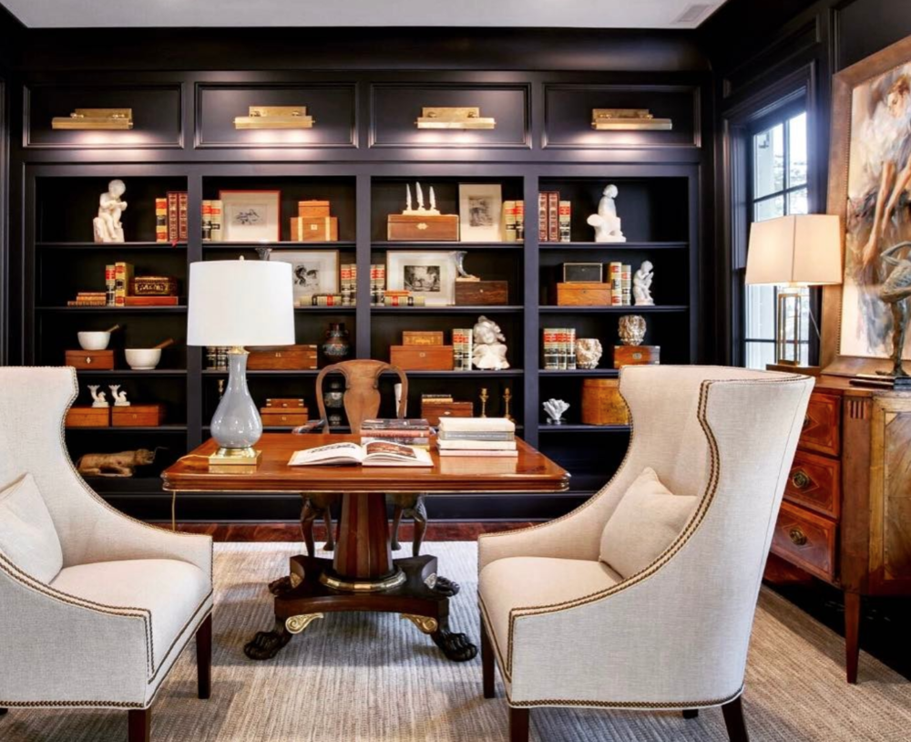 Navy library/office in the Southern Living Showcase Home by   Hatcliff Construction