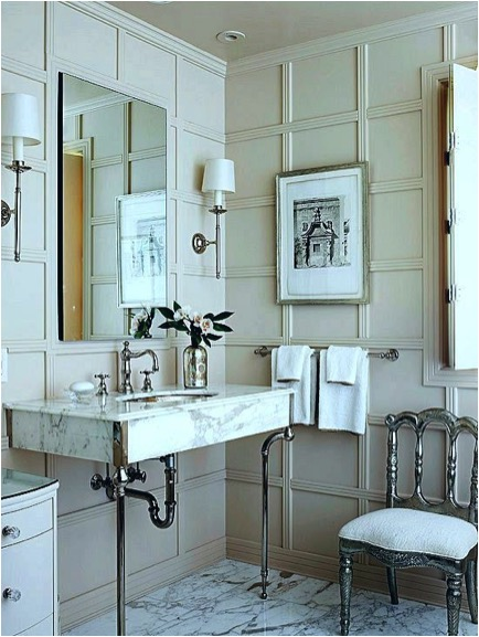 Gorgeous paneled bath with perfectly placed sconces flanking the mirror via   Better Homes and Gardens