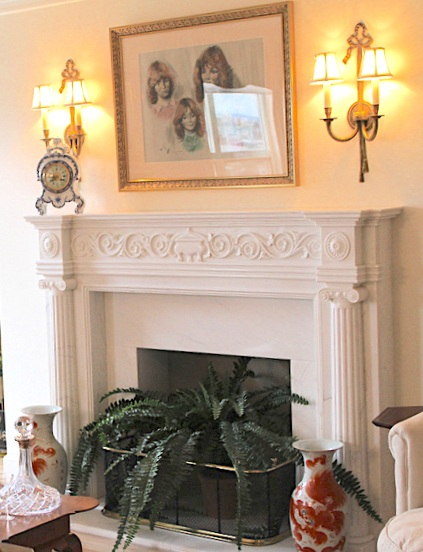 Sconces were mounted with the bulbs at a height midway between the top of the mantel and the ceiling, and centered over the mantel pillars on each side.