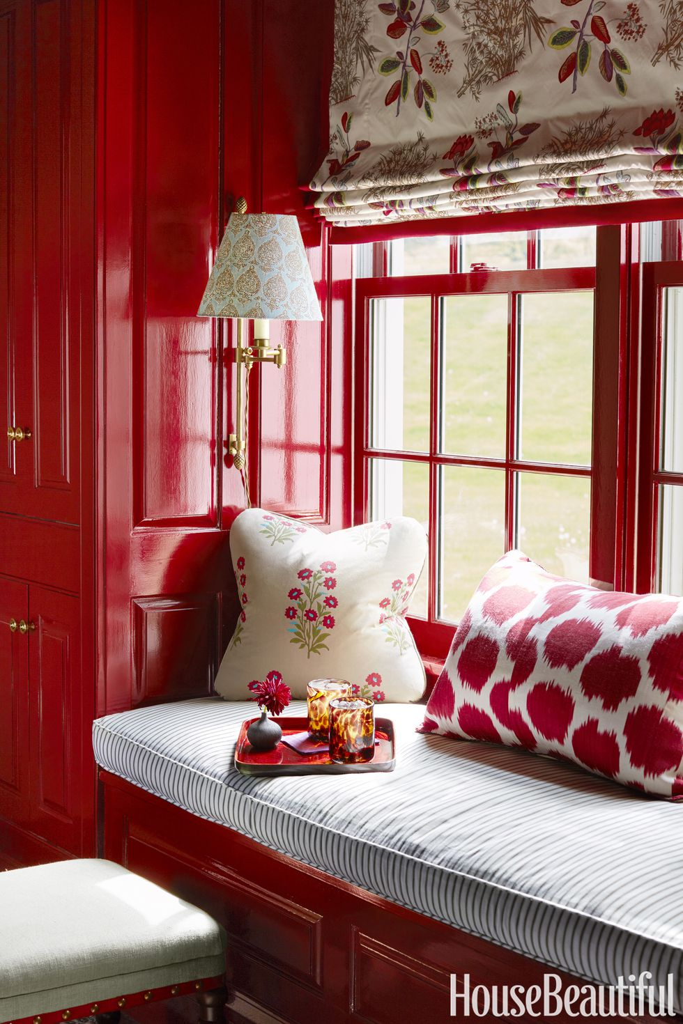 Tiny red nook in a home by   Ashley Whittaker   via   House Beautiful     Photo by     Thomas Loof