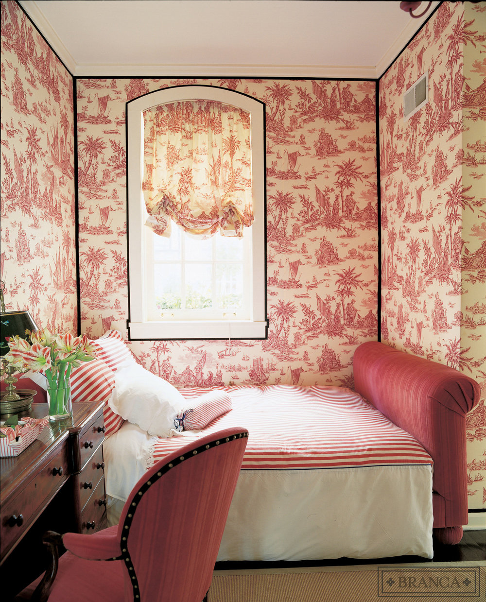 This small room is wrapped with toile upholstered walls accented with black ribbon trim, and features a soft balloon shade of the same fabric. Design by   Alessandra Branca