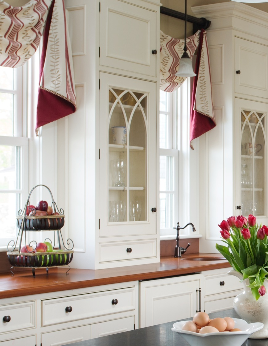 We lined these window valances with a contrasting fabric for a touch of red to highlight the striped pattern in the face fabric.