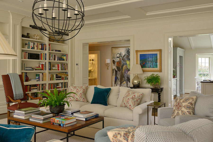This living room by the enormously talented Kentucky designer,   Matthew Carter  , is a case study in successfully mixing metal finishes in a room. Black iron table legs, chandelier and bookcase lights are paired with a brass pharmacy lamp, hammered brass side table, and gilt framed artwork. A mercury glass table lamp adds a touch of silver to the artful mix.