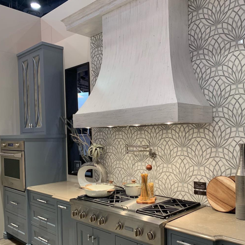 Wedgewood blue cabinetry was mixed with charcoal gray and chalky white cabinetry in this   KBIS   display with   Medallion   and   Yorktowne   cabinetry