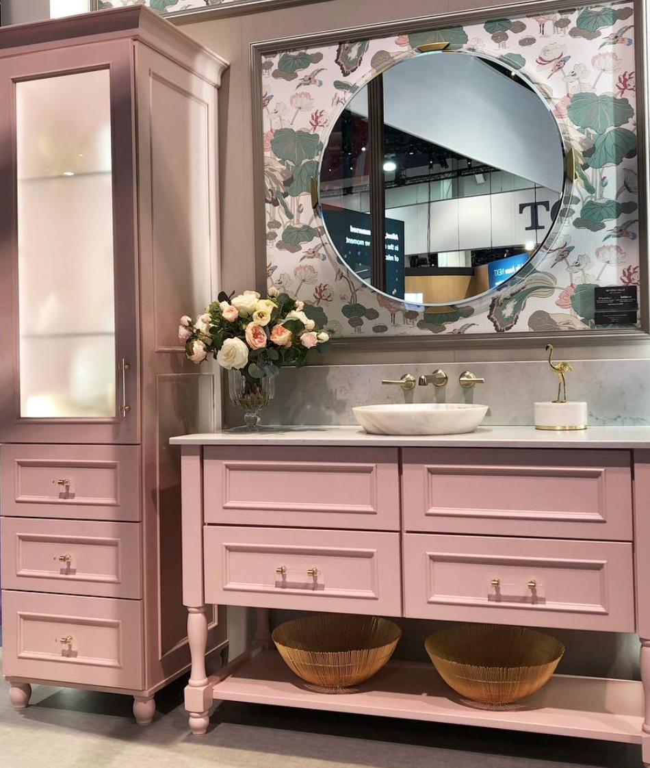 Pink cabinetry in a bath display by   Medallion cabinetry at KBIS