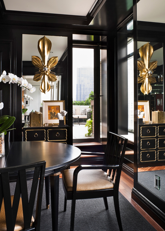 In this NYC dramatic and elegant dining space, black walls are accented with mirror panels. Design:   Celerie Kemble  , Photo:   Zach DeSart