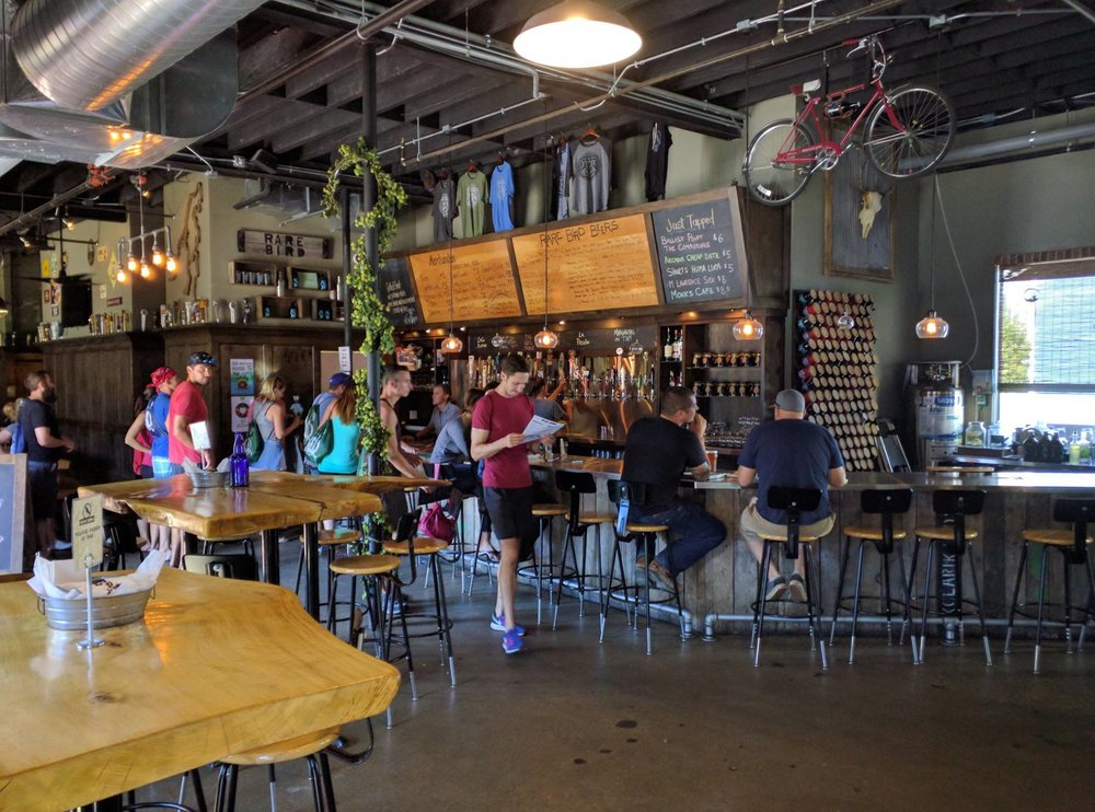 Grabbing beers at Rare Bird Pub during our Kayak, Bike and Brew tour!