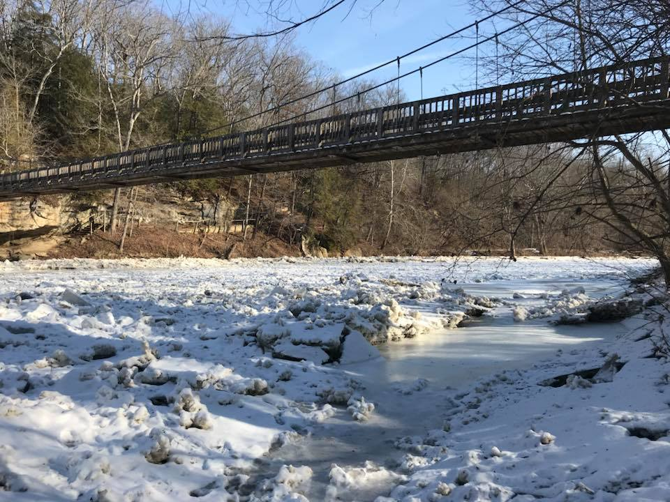 Visitors enter Turkey Run State Park by way of a suspension bridge over Sugar Creek, where cold temperatures cause an interesting build-up of ice.