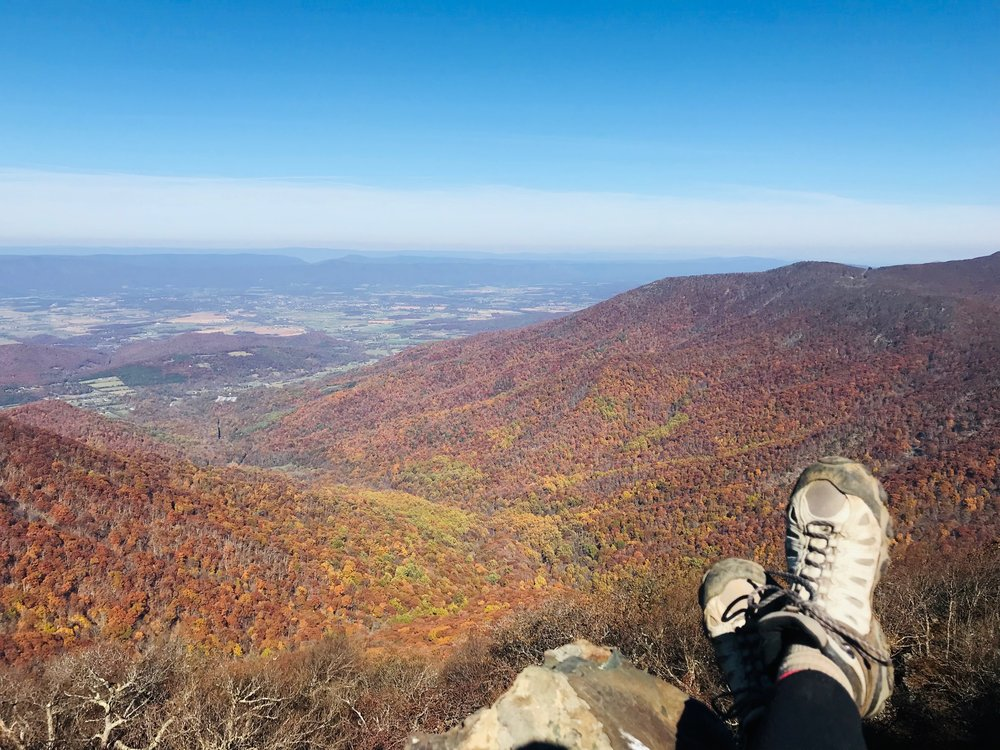 Relaxing at the top of Hawskbill Mountain. At 4,050 feet, it's the highest point in Shenandoah National Park, yet with a moderate rating, the 2.9-mile Hawksbill Loop Hike is fairly easy and quick. Take the AT up and the Lower Hawksbill back for a change of scenery.