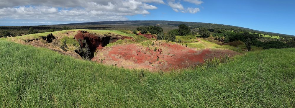 Our first hike at Hawaii Volcanoes was in the Kahuku Unit on the south end of the park. We only saw one other person as we explored the two-mile Pu'u o Lokuana Trail, which features 1868 lava flows and a grassy cinder cone and its exposed red cinder mine.