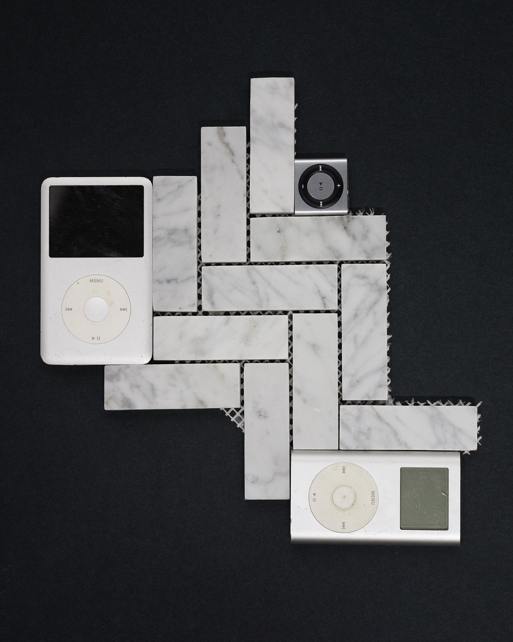 "Do the Dance iSculpture , 2016, marble tile, iPods, iPod Shuffle, 15"" x 13"" x .5""."
