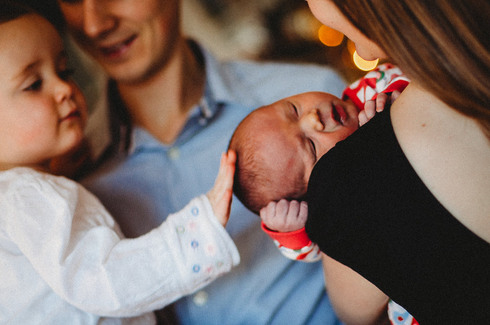 Sister sees new baby London Newborn Photographer Islington