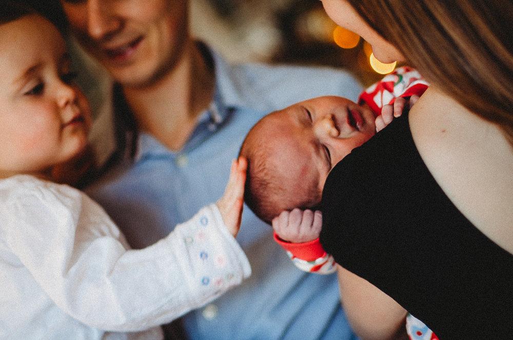 Sister sees new baby London Newborn Photographer Islington