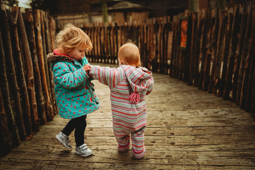 sisters_hold_hands.jpg