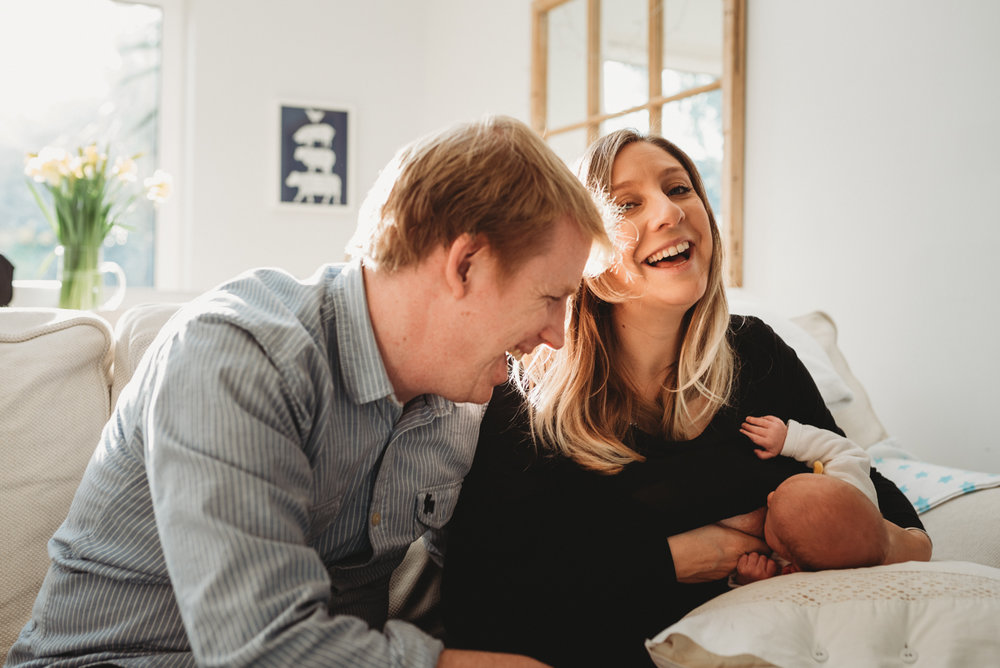 Hampshire | London Photographer, Mum Smiles with Dad and Baby