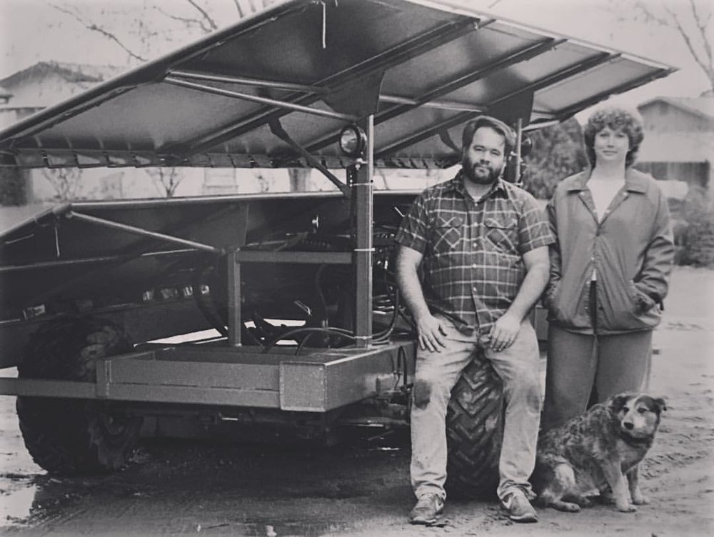 COE founders Lyman & Lois Coe 1986 with one of the first Coe Orchard Equipment Mfg machines