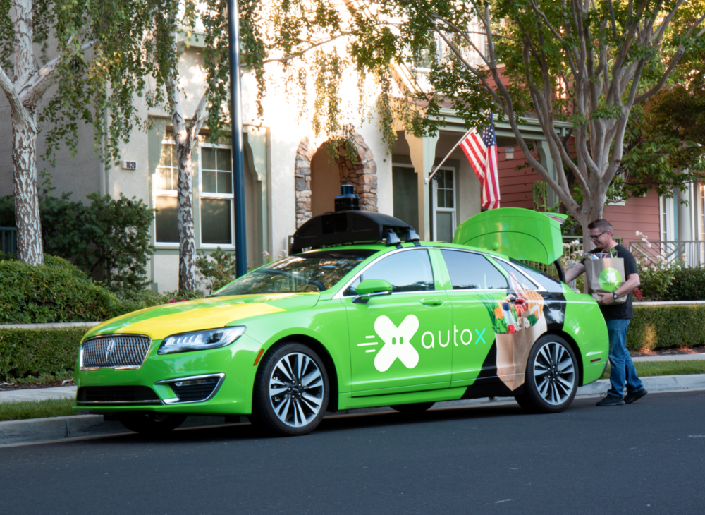 AutoX   Autonomous vehicle startup AutoX has launched a grocery delivery and mobile store pilot in a partnership with GrubMarket.com and local high-end grocery store DeMartini Orchard. If you live in certain neighborhoods in San Jose, California, you can now get some of your groceries delivered by a self-driving car. Bright green cars from the self-driving startup AutoX–with a backup driver inside–will pull up with your order in the trunk. In the backseat, the window rolls down to offer a shelf of extra food to buy. AutoX is coming to your doorstep with their autonomous grocery delivery service. They use dual A.I. combining real-time sensing and HD 3D map-based sensing and advanced A.I. software so their vehicles can react rapidly and make safe driving decisions.