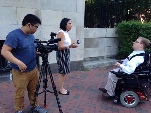 Matthew Shapiro being interviewed by a reporter.