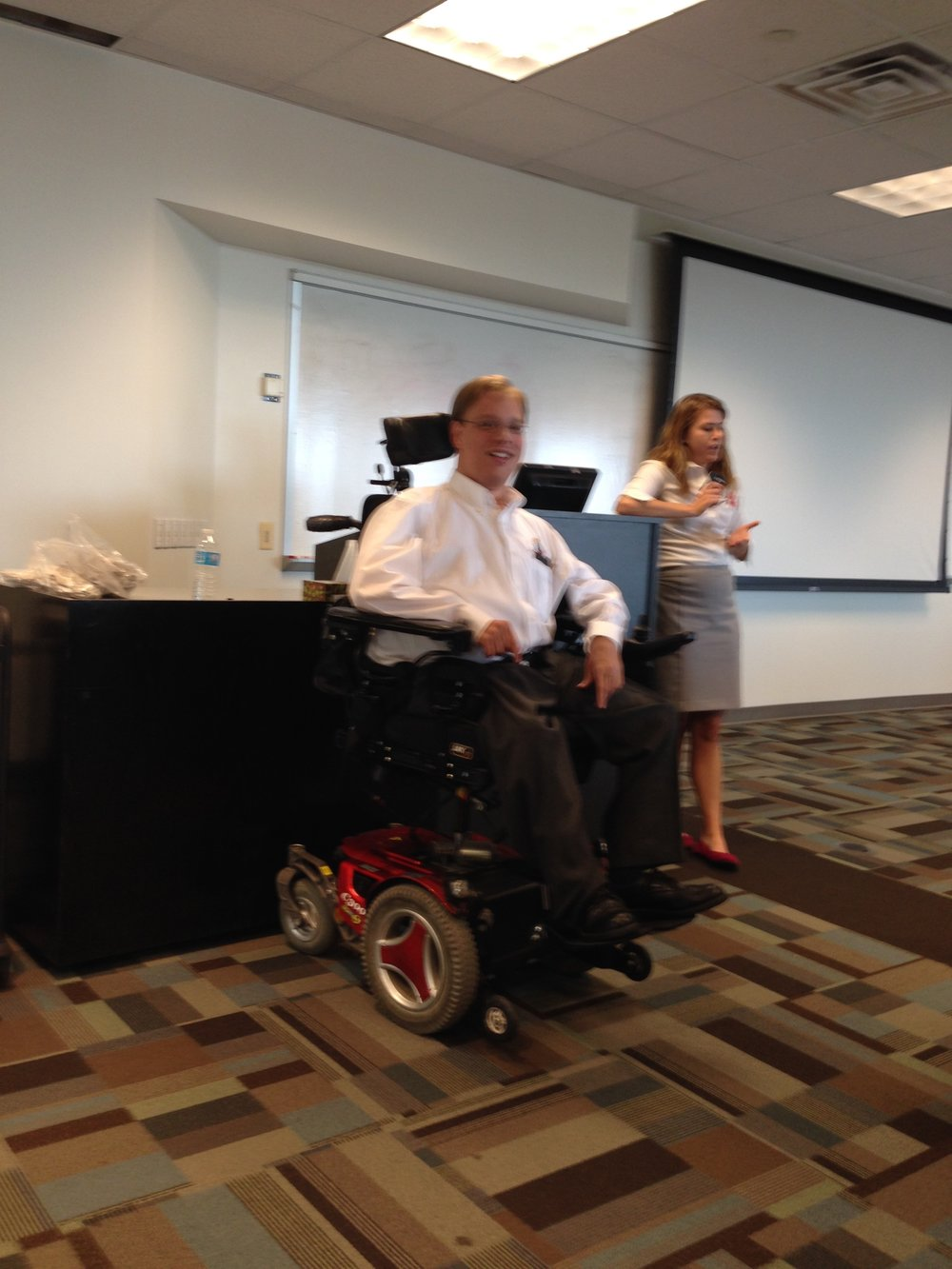 PHOTO: Matthew presents along with staff from Sportable about his experience as an athlete in the importance of being on a team.  This presentation was part of Suntrust's ADA 25 Celebration.