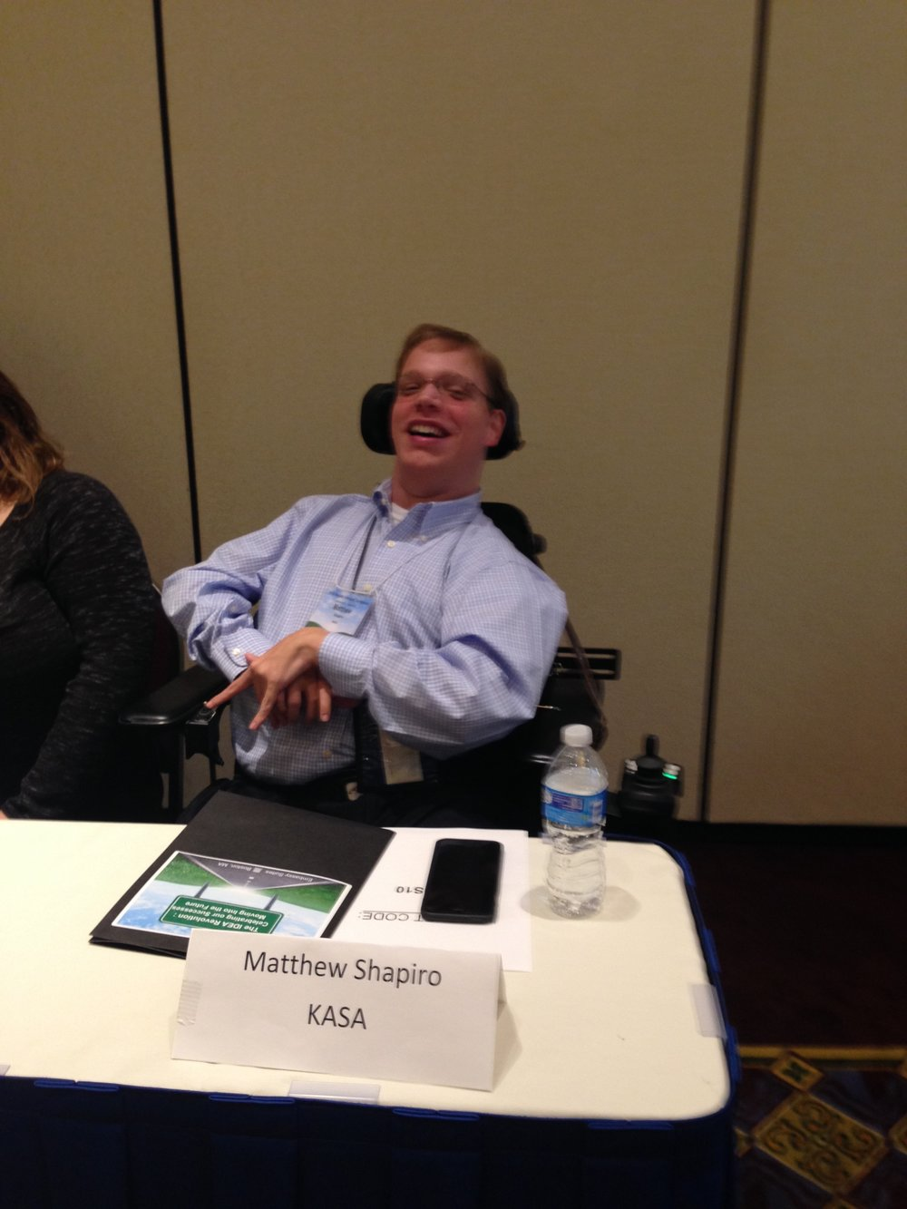 PHOTO: Matthew smiles for the camera as he awaits the start of the Youth involvement breakout strand at the NEPACT Region 1 annual conference in Boston Massachusetts.  A group of 8 panelist was there to discuss how the parent centers in region one could get more youth involvement in their projects.