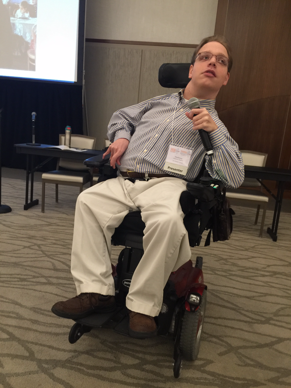 PHOTO: Matthew in his wheelchair presenting his keynote in South Carolina.